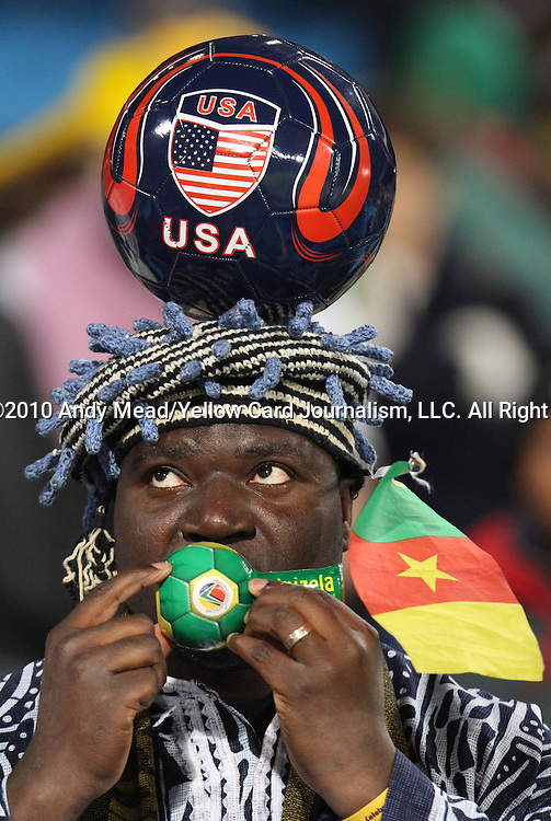 19 JUN 2010: Cameroon and U.S. fan. The Cameroon National Team lost 1-2 to the Denmark National Team at Loftus Versfeld Stadium in Tshwane/Pretoria, South Africa in a 2010 FIFA World Cup Group E match.