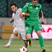 Bursaspor's Volkan SEN (L) and Gomel's Maksim LISOVIY (R) during their UEFA Europa League Third qualifying round, First leg soccer match Bursaspor between Gomel at the Ataturk stadium in Bursa Turkey on Thursday 28 July 2011. Photo by TURKPIX