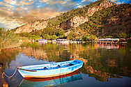 Ferry row boat on the Dalyan Çay River looking towards boats & fish restaurant. Mediterranean coast Turkey .<br /> <br /> If you prefer to buy from our ALAMY PHOTO LIBRARY  Collection visit : https://www.alamy.com/portfolio/paul-williams-funkystock/dalyan-lycian-tombs-and-kaunos.html<br /> <br /> Visit our TURKEY PHOTO COLLECTIONS for more photos to download or buy as wall art prints https://funkystock.photoshelter.com/gallery-collection/3f-Pictures-of-Turkey-Turkey-Photos-Images-Fotos/C0000U.hJWkZxAbg
