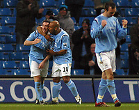 Photo: Paul Thomas.<br />Manchester City v Scunthorpe United. The FA Cup.<br />07/01/2006.<br />Manchester City players Trevor Sincair (C) and Stephen Ireland (R) celebrate Robbie Fowler's (L) goal.