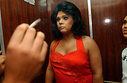 There are beauty pageants for neary all tastes and styles in Venezuela.  Johan Rincon gets ready  for the Ms. Gordibella(Ms. Fat and Beautiful) competition, a contest for large men in drag. Rincon also helped organize the competition.  Fashion and looking good are top priorities in Venezuela, where there is a general culture of beauty.  It is a culture that permeates all walks of life and covers the country like a blanket. Girls enter beauty pageants as toddlers and young women and men get plastic surgery as teens.  Venezuela is a country where thongs and short skirts are the norm, cleavage awaits around every corner and metrosexual men abound.