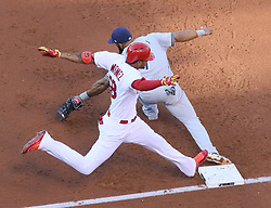 June 15, 2017 - St Louis, MO, USA - Milwaukee Brewers first baseman Eric Thames receives the throw just before St. Louis Cardinals' Jose Martinez reaches first base on a groundout to end the second inning during a game between the St. Louis Cardinals and the Milwaukee Brewers on Thursday, June 15, 2017, at Busch Stadium in St. Louis. The Brewers won 6-4. (Credit Image: © Chris Lee/TNS via ZUMA Wire)