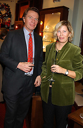 BETHELL CODRINGTON and the HON.ALEXDANDRA FOLEY at a drinks party for the Game Conservancy Trust's committee held at Williams & Son, 10 Mount Street, London WlK hosted by Willaim & Lucy Asprey on 6th December 2005.<br /><br />NON EXCLUSIVE - WORLD RIGHTS