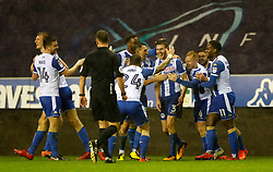 Wigan Atheltic's Callum Elder (fourth right) celebrates scoring his side's third goal of the game during the Emirates FA Cup, Third Round Replay at the DW Stadium, Wigan.