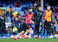 Football - 2019 / 2020 Premier League - Everton vs. Manchester United<br /> <br /> Bruno Fernandes of Manchester United warms up before today's game, at Goodison Park.<br /> <br /> COLORSPORT/ALAN MARTIN