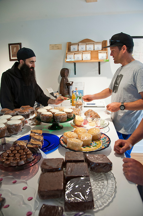 Professional mountain biker Andrew Shandro buys baked goods at the Jam Pot in Eagle Harbor Michigan.