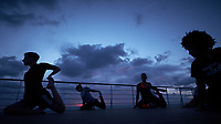 Yoga at Sunset on the Deck of the MV Explorer. Image taken with a Fuji X-T1 camera and Zeiss 12 mm f/2.8 lens (ISO 1600, 12 mm, f/13, 1/60 sec). Raw image processed with Capture One Pro, and Photoshop CC 2014.