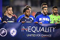 Football - 2020 / 2021 Sky Bet Championship - Millwall vs Queens Park Rangers - The Den<br /> <br /> Mahlon Romeo of Millwall with Yoann Barbet of Queens Park Rangers as players join together with their anti-racism banner.<br /> <br /> COLORSPORT/ASHLEY WESTERN