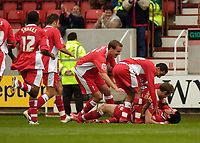 Photo: Leigh Quinnell.<br /> Swindon Town v Grimsby Town. Coca Cola League 2. 14/10/2006. Swindons Lee Peaock(bottom) celebrates with his teammates after his goal.