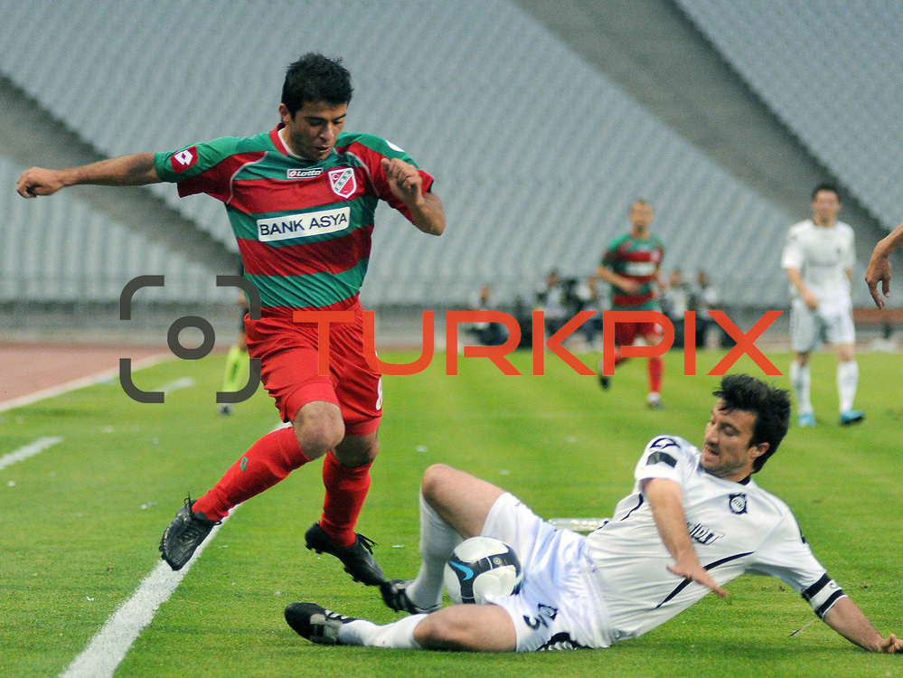 Karsiyakaspor's Ayhan EVREN (L) and Altayspor's Onur NASUHOGULLARI (R) during their Play Off First leg match at Ataturk olympic Stadium in Istanbul Turkey on Monday, 17 May 2010. Photo by TURKPIX