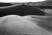 Black and white photo of sand dunes in Death Valley National Park, California.