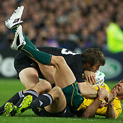 Quade Cooper, Australia, is tackled by Richard Kahui and Conrad Smith, (left), New Zealand, during the New Zealand V Australia Semi Final match at the IRB Rugby World Cup tournament, Eden Park, Auckland, New Zealand, 16th October 2011. Photo Tim Clayton...