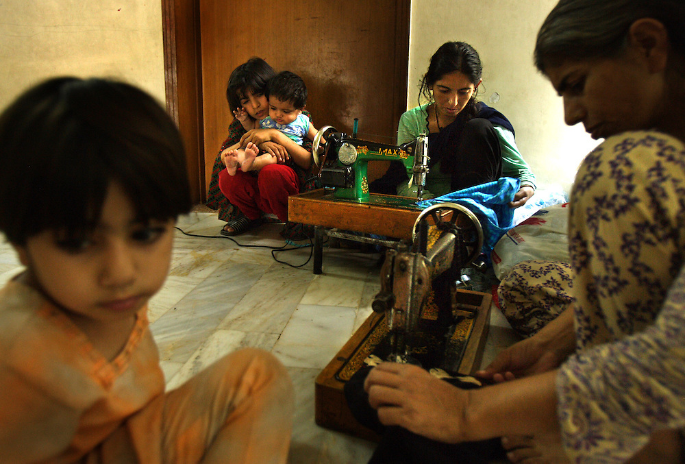 Women practice their sewing skills at Dastak, a shelter opened in 1990 for abused women seeking refuge by the AGHA Legal Aid Cell, Lahore, Pakistan, May 2, 2003.