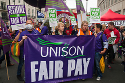 London, July 10th 2014. Unison protesters demand fair pay as thousands of striking teachers, government workers and firefighters march through London in protest against cuts and working conditions.