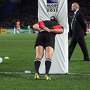 Riacard Kahui, New Zealand stretches against a post as coach Graham Henry walks past before the start of the New Zealand V France, Pool A match during the IRB Rugby World Cup tournament. Eden Park, Auckland, New Zealand, 24th September 2011. Photo Tim Clayton...