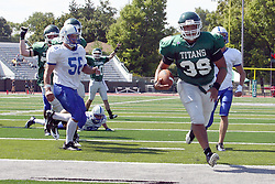 17 September 2011: Kevin Glock falls to the wayside as Sean Conley continues up the field and over the goal line during an NCAA Division 3 football game between the Aurora Spartans and the Illinois Wesleyan Titans on Wilder Field inside Tucci Stadium in.Bloomington Illinois.