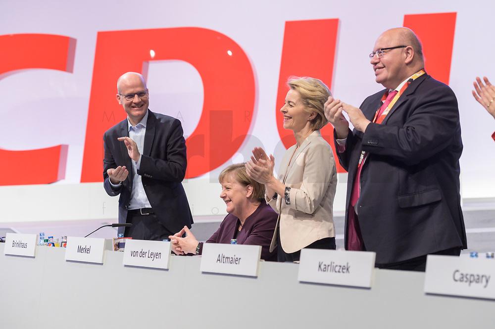 22 NOV 2019, LEIPZIG/GERMANY:<br /> Ralph Brinkhaus, CDU, Vorsitzender der CDU/CSU Bundestagsfraktion, Angela Merkel, CDU, Bundeskanzlerin, und Ursula von der Leyen, CDU, gewaehlte Praesidentin der Europaeischen Kommission, und Peter Altmeier, CDU, Bundeswirtschaftsminister, (v.L.n.R.), Applaus fuer Merkel waehrend der Eroeffnung des Parteitages durch AKK, , CDU Bundesparteitag, CCL Leipzig<br /> IMAGE: 20191122-01-023<br /> KEYWORDS: Parteitag, party congress, Applaus, applaudiren, klatschen