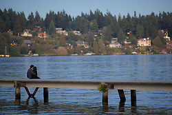 North America, United States, Washington, Mercer Island, couple on dock over Lake Washington