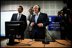 London Mayor Boris Johnson (centre) holds a video conference call with students and pupils from four African schools during a visit to Amity University in Uttar Pradesh near Delhi, where he addressed members of the university and took questions from Indian students, on the second day of a six-day tour of India, where he will be trying to persuade Indian businesses to invest in London, Monday November 26, 2012. Photo by Andrew Parsons / i-Images