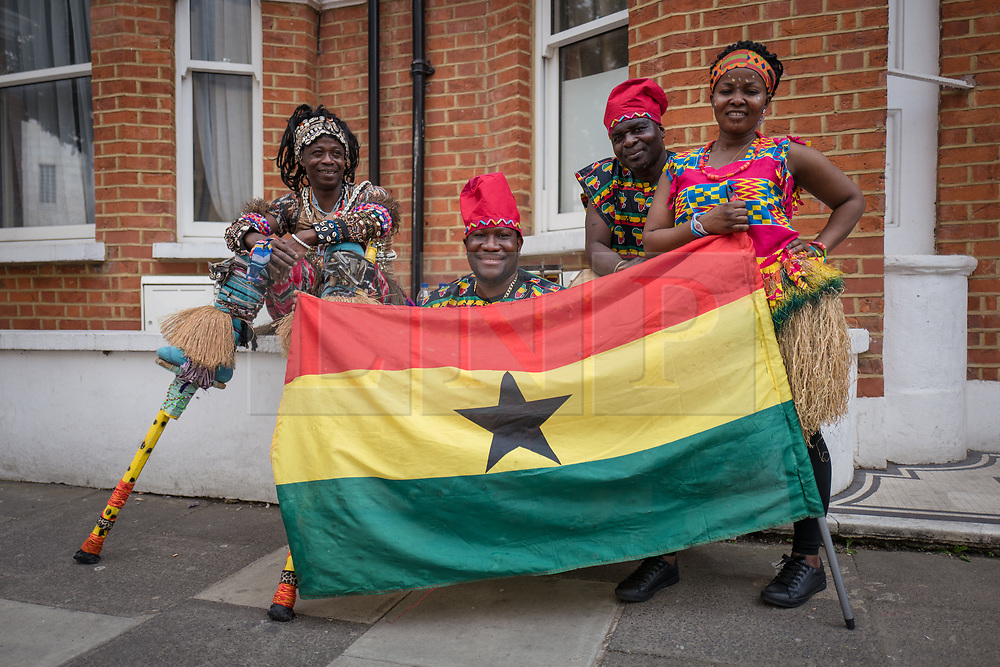 © Licensed to London News Pictures. 22/06/2017. London, UK. Members of the Gahu Dramatic Arts group wait to perform at the inauguration of the African Caribbean War Memorial in Windrush Square in Brixton, south London, on Windrush Day. The memorial remembers the many African and Caribbean servicemen that fought in the Second World War. Photo credit: Rob Pinney/LNP