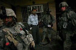 Engineers with 1st Platoon Alpha Co. 3-25 BSTB 2BCT 82nd Airborne Division apprehend a suspected Shia militiamen during a morning raid in the northern sector of the Baghdad Adhamiya district on Tuesday April 24, 2007.