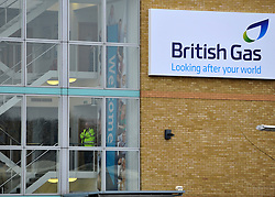 © Licensed to London News Pictures. 30/01/2012, Staines, UK. A police officer stands inside the building. 6 activists have barricaded themselves into meeting rooms on two floors of British Gas offices in Staines, Middlesex, as part of the 'Winter Warm-Up' weekend called by the campaign group Fuel Poverty Action. British Gas is being targeted as one of the Big Six energy companies making profits out of rising energy bills.   Photo credit : Stephen Simpson/LNP