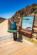Hiker and interpretive sign at Bechers Bay, Santa Rosa Island, Channel Islands National Park, California USA