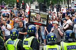 © Licensed to London News Pictures. 09/06/2018. London, UK. Members of the UK far right activist groups protest outside the gates to 10 Downing Street and surrounding areas against the prison sentence of TOMMY ROBINSON, aka STEPHEN YAXLEY-LENNON. Mr ROBINSON was arrested and sentenced to 13 months in prison on May 25th outside Leeds Crown Court while while breaking a reporting restriction on a case set by the judge. Photo credit: Hugo Michiels/LNP