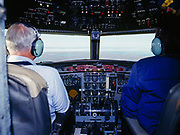 Don Nyberg and Dave Henley in cockpit of Pacific Alaska's Fokker F-27 on final approach for Point Barrow, Alaska.