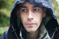 Portrait of man looking sad with his hood up,