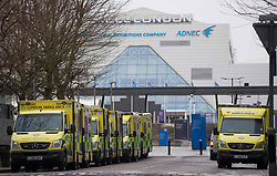 © Licensed to London News Pictures.03/01/2021, London, UK. Ambulances & training vehicles are lined up at the Nightingale hospital in East London as UK recorded 57,725 new coronavirus cases yesterday, its highest ever daily total. Photo credit: Marcin Nowak/LNP