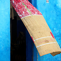 Africa, Morocco, Rabat. Curtain blows on street of Kasbah of Oudaya, a UNESCO World Heritage Site.