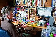 TV hockey and fly tying at camp.