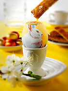 Hand painted chicken eggs with traditional Easter chicks design being eaten for breakfast