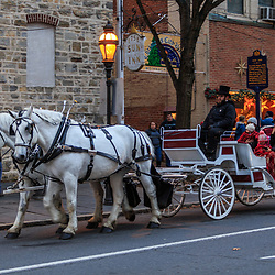 Bethlehem, PA, USA - December 14, 2014: A horse drawn carriage carries visitors through the city streets before the Christmas holiday.