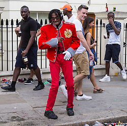 "London, August 28 2017. ""Michael Jackson"" dances on Ladbroke Grove on Day Two of the Notting Hill Carnival, Europe's biggest street party held over two days of the August bank holiday weekend, attracting over a million people. © Paul Davey."