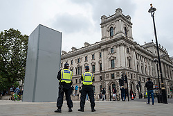 © Licensed to London News Pictures. 12/06/2020. London, UK. Two police officers stand in front of the Winston Churchill statue in Parliament Square, which has been temporarily boxed in. Statues have become fiercely contested after the statue of Edward Colston in Bristol was torn down by protesters. Protests have taken place across the United States and in cities around the world in response to the killing of George Floyd by police officers in Minneapolis on 25 May. Photo credit: Rob Pinney/LNP