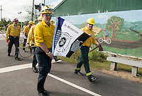 Members of Laconia Fire Department march in memoriam to the fallen Arizona Firefighters during Saturday's WOW Fest in Laconia.  (Karen Bobotas/for the Laconia Daily Sun)