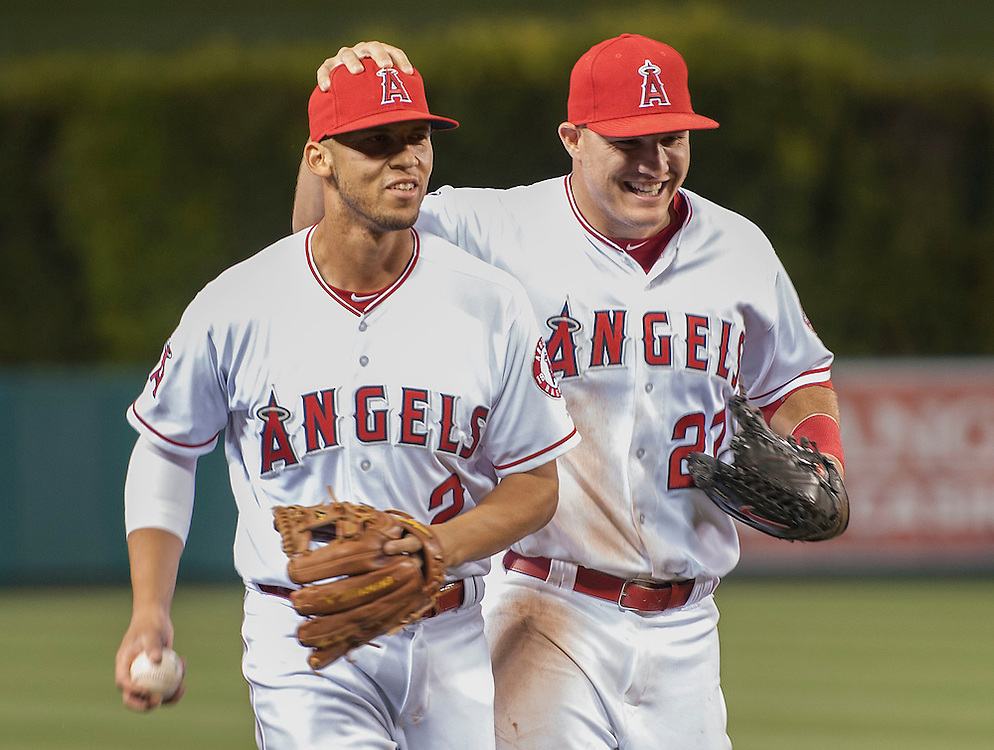 The Angels' Mike Trout congratulates Andrelton Simmons after making a nice play during the Angels' 9-4 victory over the Kansas City Royals Tuesday night at Angel Stadium.<br /> <br /> <br /> ///ADDITIONAL INFO:   <br /> <br /> angels.0427.kjs-pre  ---  Photo by KEVIN SULLIVAN / Orange County Register  --  4/26/16<br /> <br /> The Los Angeles Angels take on the Kansas City Royals Tuesday at Angel Stadium.<br /> <br /> <br />  4/26/16
