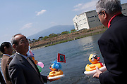Dignitaries prepare to launch large rubber ducks in to the Sakawa River during the Ashigara River festival, Kintaro duck-race in Matsuda, Kanagawa, Japan April 25th 2010