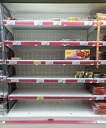 © Licensed to London News Pictures. 21/09/2021. London, UK. Empty shelves of meat packed food in Sainsbury's, north London, Fears of food shortages grow after two of the UK's biggest Carbon Dioxide (CO2) producers halted production last week due to soaring gas prices. UK food producers and supermarkets are warning that shoppers are likely to face food shortage caused by a lack of gas could hit this week. Photo credit: Dinendra Haria/LNP