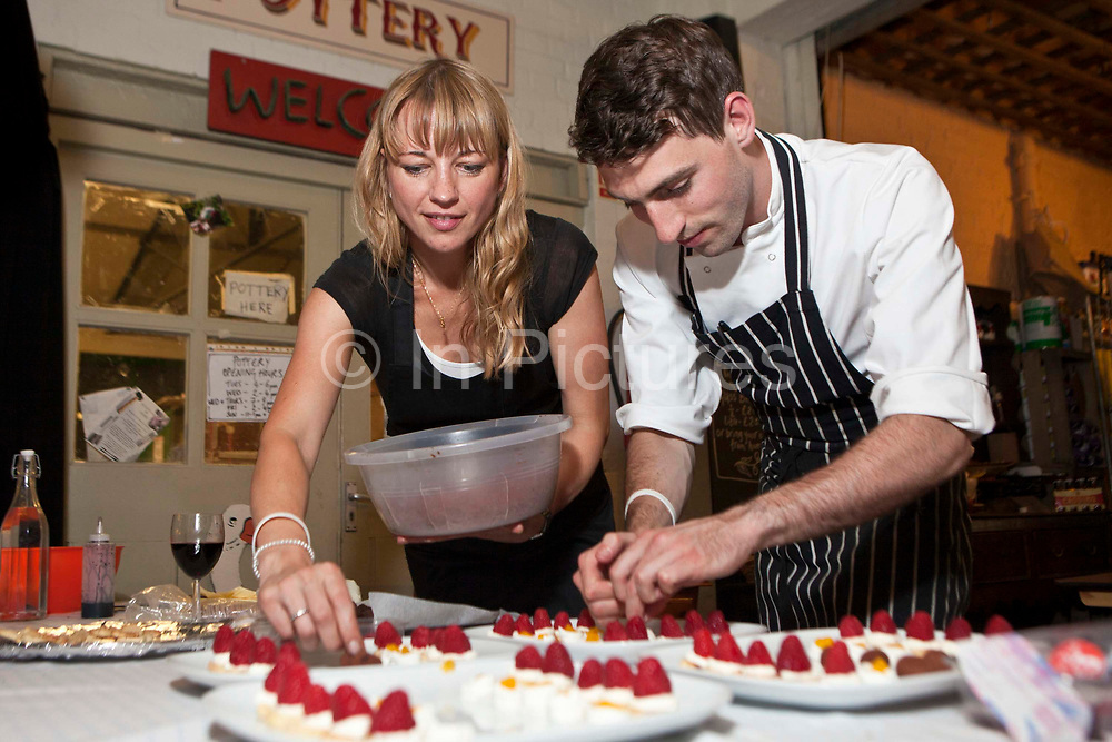 """Preparing dessert. Radio DJ Sara Cox 'does a Delia' hosting a pop up supper for Oxfam<br /> Radio DJ Sara Cox swaps her microphone for an oven to host a special one off pop up restaurant with Oxfam. <br /> The popular radio one DJ cooked a South American themed three course dinner for guests at Hackney City Farm in London. Co-hosted with Oxfam, Sara entertained a varied group of diners including fellow DJs, well known food bloggers and local food producing heroes.<br /> Sara Cox said: """"I love cooking and entertaining people so I'm really happy to be 'doing a Delia' and swapping a radio studio for a kitchen for the night to cook up a South American supper for my guests. Hosting the event is a fun and creative way for me to show my support for Oxfam's campaign to share the world's food resources more fairly and eradicate hunger."""""""