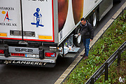A driver makes himself a cup of tea as freight Lorries line up in queues contained in operation Stack on the M20 motorway at Ashford, Kent, United Kingdom on the 23rd of December 2020. Truck drivers have been waiting in operation stack on the M20 motorway for over 48 hours now, France closed it's boarders with the UK after a new faster spreading strain of the COVID-19 virus broke out in Kent. (photo by Andrew Aitchison / In pictures via Getty Images)