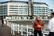 Woman chatting with a man at the waterfront and marina at Castle Quay, St Helier, Jersey, CI