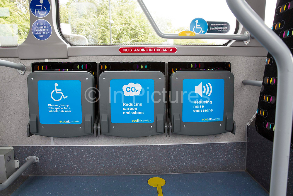 Priority seats on an Ecolink bus, one of Nottingham's zero emissions buses, in Nottingham, Nottinghamshire, United Kingdom. The electric buses are part of the City Council's campaign to reduce noise and air pollution in the city centre, while still providing accessible public transport.