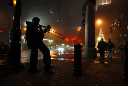 A cool fog wraps around Trade and Tryon late one night as  the sound of a trombone resonates through Charlotte's uptown. © The Charlotte Observer/L.MUELLER