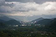 The factories and  favelas of Cubatão surrounded by jungle covered hills