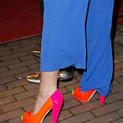 NLD/Amsterdam/20120217 - Premiere Saturday Night Fever, neon schoenen van Monique des Bouvrie
