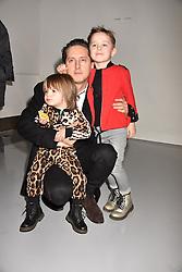 Carl Barat and his sons Eli Barat & Ramone Barat at the LFW Sponge Bob Gold presentation at The Atrium, The Store Studios, 180 The Strand, London England. 18 February 2017.