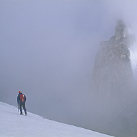 A mountaineer crosses the Vowell Glacier under the Howser Spires Massif in Bugaboo Provincial Park, in the Purcell Mountains of British Columbia, Canada.